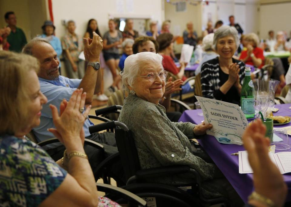 "Sadie Snyder, 105, smiled as she received an award for being a Centenarian during ""The Party of a Century."""